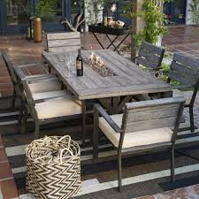 patio table and chairs clearance belham living silba piece envirostone fire pit patio dining set teak