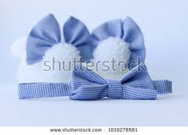 white and blue bows knit white baby booties fluffy stock photo 1010278561