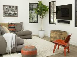 Wall Art For Living Room by Furniture Round Leather Pouf With White Rug And Wood Chair Plus