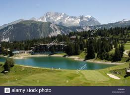 golf course and hotel by lake above courchevel 1850 in the french