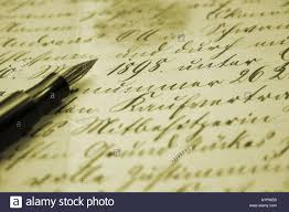 pen writing on paper an ink pen is put on the paper which consists of cursive writings an ink pen is put on the paper which consists of cursive writings
