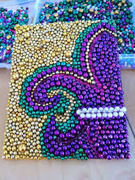 beads glued to a canvas in a fleur de lis would be cute to do in