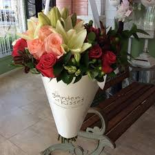 flowers in a box flowers in cone style bouquet garden of kisses