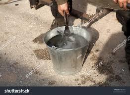 medieval craftsman blacksmith cooling piece iron stock photo