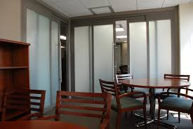 black glass divider door combined by white chairs and sofa also