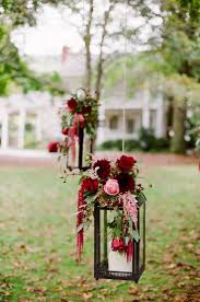 red flowers on black lantern wedding decor ideas deer pearl flowers