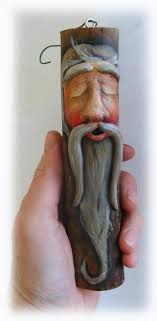 clay carved wood spirit santa ornament made from tree branch these