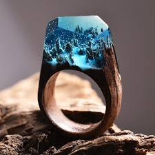 rings world images Beautiful wood and resin rings with tiny aliens worlds inside jpg