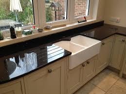 silver quartz kitchen worktop with integrated pop up sockets