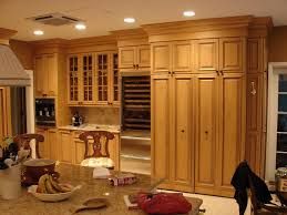 rosewood red amesbury door tall kitchen pantry cabinet backsplash