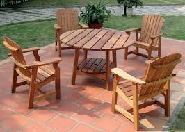 round wood patio table round picnic table with four deck chairs wooden patio furniture
