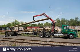 flat or open bed truck fitted with knuckle boom for moving