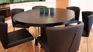extending pedestal dining table extended round dining table black ash round extending dining table
