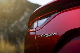 kia unveils the 2018 kia stinger at detroit auto show