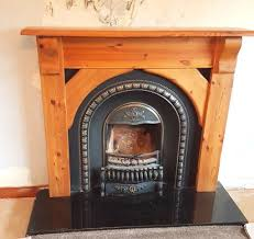 feature cast iron fireplace with wooden pine surround and marble