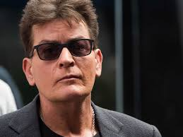 charlie sheen sues national enquirer over corey haim sexual