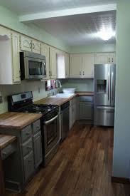 kitchen dark wood flooring and beadboard backsplash idea feat two