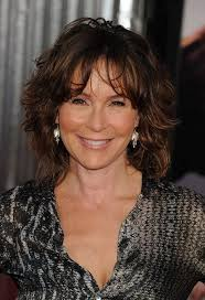 mid lengh hairstyles for over 50 with fringe jennifer grey medium messy hairstyle with bangs for women over 50