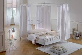 stylish white polished metal canopy bed with 4 metal poles and