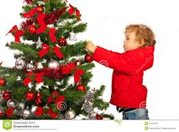 toddler boy decorate tree royalty free stock photos
