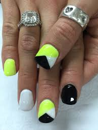 super funky neon yellow white and black geometric gel nails