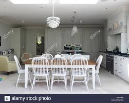 pendulum lighting in kitchen open plan kitchen and dining area with tables chairs and pendant