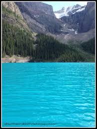 canoe across the turquoise waters of moraine lake