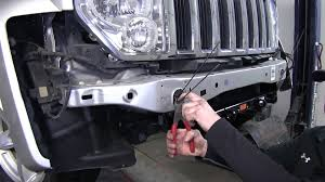 installation of the blue ox base plate kit on a 2008 jeep liberty