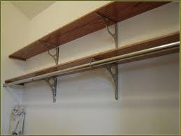 a closet closet shelves with hanging rod
