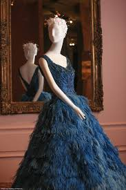 dion unveils four metre tall gown at 200 years australian