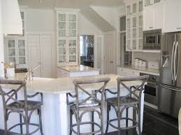 white wooden kitchen cabinet and island with white granite
