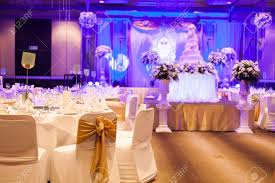 marriage celebration with cake banquet table flowers and