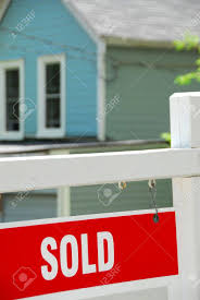 sold sign near a house stock photo picture and royalty free image