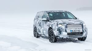 land rover snow 2015 land rover discovery sport on snow front hd wallpaper 67