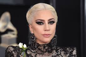 gaga earrings grammys 2018 gaga brings drama to the grammys carpet in