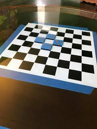 turned an old glass top coffee table into a chess board album on