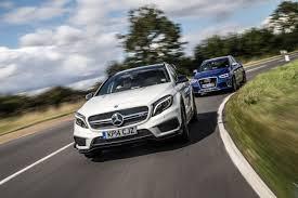 audi q3 vs gla mercedes gla45 amg vs audi rs q3 test review by car magazine