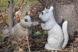 squirrel and rabbit garden ornaments stock photo picture and