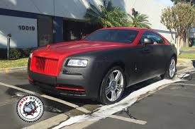 matte red bentley rolls royce wraith wrapped in matte black with chrome red wrap