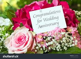 english wedding anniversary card pink flowerscongratulations stock