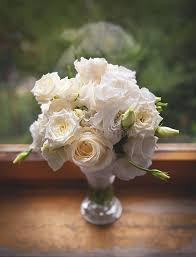 White Roses In A Vase Beautiful White Roses In A Glass Vase Near Window Stock Photo