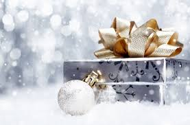 silver gift box with gold bow and silver glitter ornament