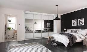 Black Glass Sliding Wardrobe Doors by Wardrobes With Sliding Doors Fitted Bedrooms Sharps