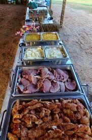 country buffet for a wedding reception under an open barn chicken