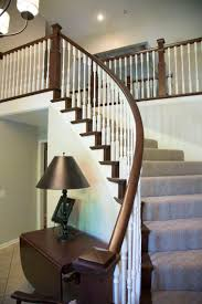 Banister Ends Curved Staircase With Wooden Balusters Tread Caps And Risers