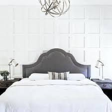 two tone oak bed with white and blue bedding transitional bedroom