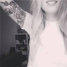 black flowers arm tattoo tattoomagz