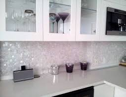 white mosaic tile kitchen backsplash hood with curved gray