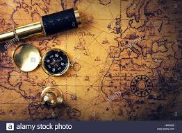 Old World Map Vintage Compass And Spyglass On Old World Map Copy Space Stock