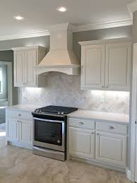 back splash spacious white kitchen with light travertine backsplash and